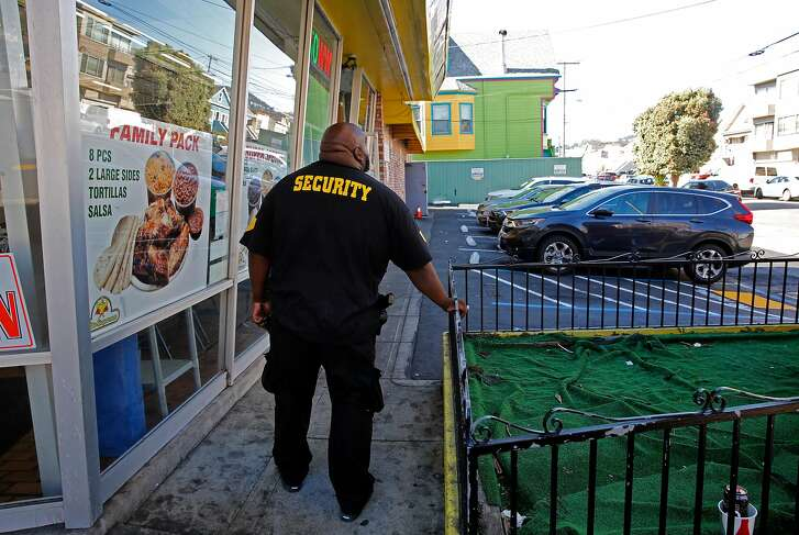 Vic Perkins, (left) a private security guard in front of the El Pollo Supremo restaurant along Mission St. near Geneva in San Francisco, Ca. as seen on Thurs. Sept. 28, 2017. SF Cookies , a medical cannabis dispensary a few doors down from the restaurant provides the security guard to patrol the parking lot of the restaurant making sure their customers don't park and take up their spaces while visiting the dispensary.