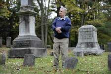 Robert Keeler Reynolds, 93, recently retired as president of the Ridgebury Cemetery Association in Ridgefield, walks the property Monday, Oct. 16, 2017.
