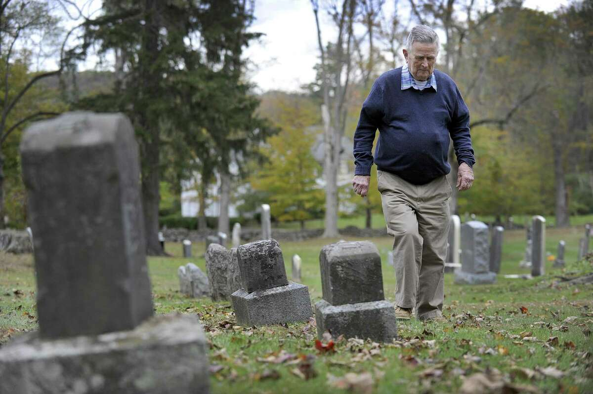 Robert Keeler Reynolds, 93, recently retired as president of the Ridgebury Cemetery Association in Ridgefield, walks the property Monday, Oct. 16, 2017.