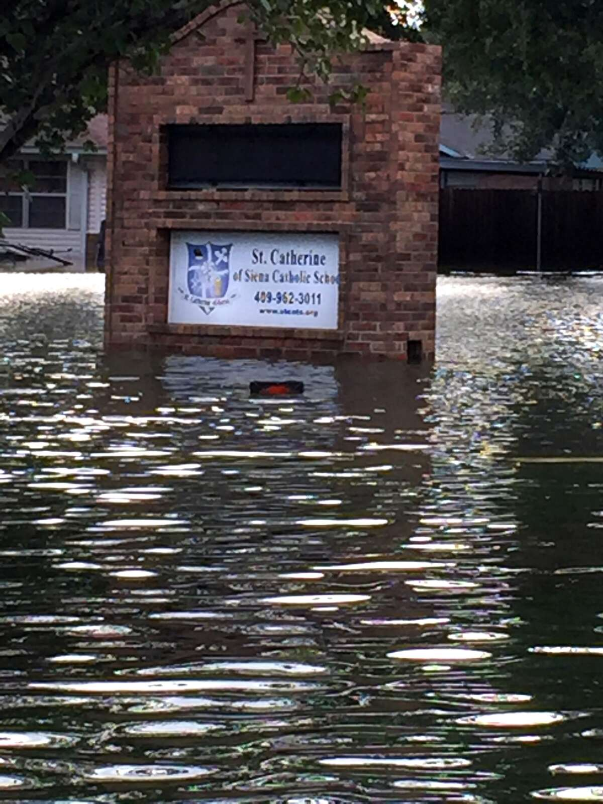 Water flloods the the neighborhood surrounding St. Catherine of Siena Catholic School in Port Arthur after the remnants of Hurricane Harvey passed over Southeast Texas in late August. (Photo provided by St. Catherine)