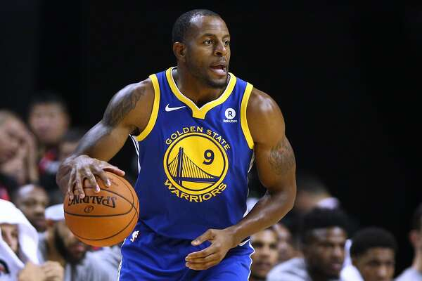 SHANGHAI, CHINA - OCTOBER 08: Andre Iguodala #9 of the Golden State Warriors in action during the game between the Minnesota Timberwolves and the Golden State Warriors as part of 2017 NBA Global Games China at Mercedes-Benz Arena on October 8, 2017 in Shanghai, China. (Photo by Zhong Zhi/Getty Images)