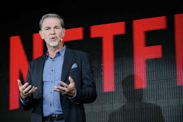 "Reed Hastings, chief executive officer of Netflix Inc., speaks during a news conference in Tokyo, Japan, on Monday, June 27, 2016. Netflix intends to produce more original Japanese television shows after the 10-episode ""Hibana"" series it introduced earlier this month beat the company's expectations by drawing viewers from Brazil to Germany and the U.S. Photographer: Akio Kon/Bloomberg"