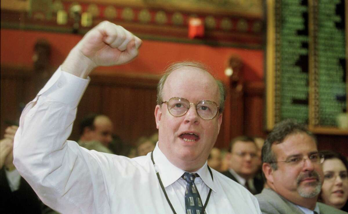 Then State Rep. Robert Keeley of Bridgeport raises his hand to cheer an introduction during the opening of the General Assembly in 2004.