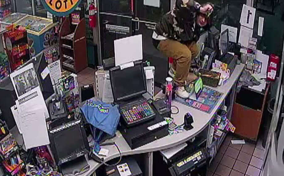 """""""Three young men caught on surveillance armed as they rob Houston gas station""""Oct. 17, 2017"""