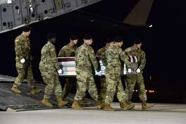 A U.S. Army carry team transfers the remains of Army Staff Sgt. Dustin Wright of Lyons, Ga., earlier this month.