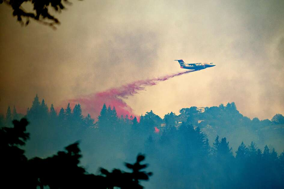 A tanker drops retardant on the Bear Bear fire in Boulder Creek, Calif., on Tuesday, Oct. 17, 2017.