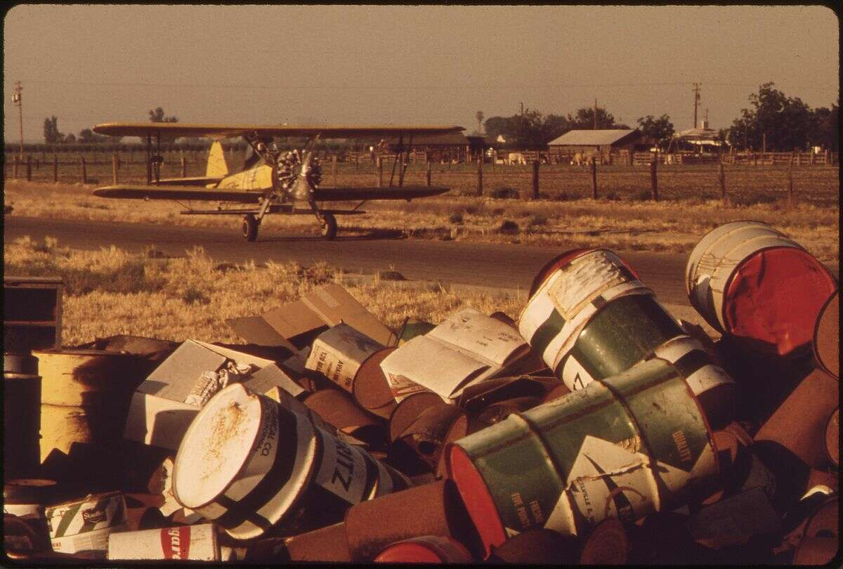 Discarded pesticide cans in Fresno, California.