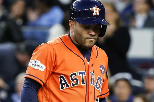 Houston Astros second baseman Jose Altuve walks off the field after striking out during the fourth inning of Game 4 of the ALCS at Yankee Stadium on Tuesday, Oct. 17, 2017, in New York. ( Karen Warren  / Houston Chronicle )