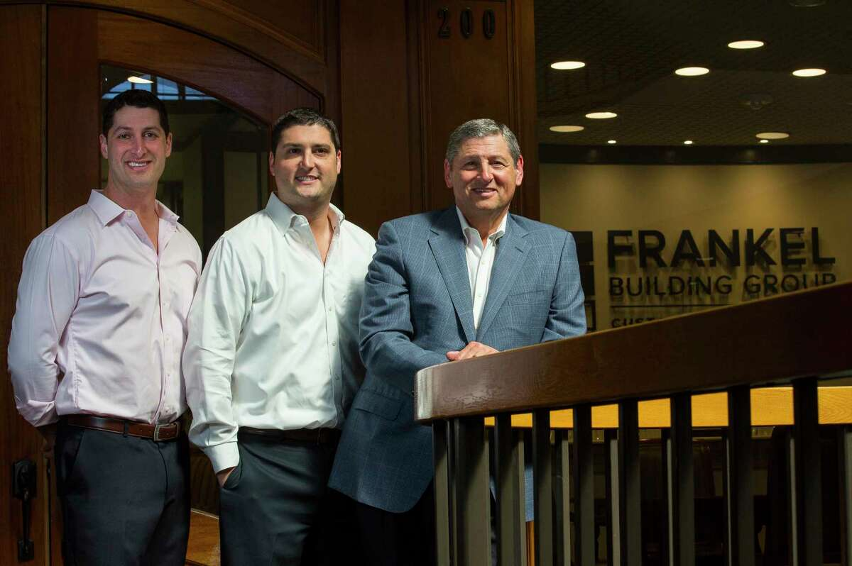 Brothers Kevin and Scott Frankel pose with their father Jim Frankel outside of their office on Tuesday, Oct.17, 2017, in Houston. (Annie Mulligan / Freelance)