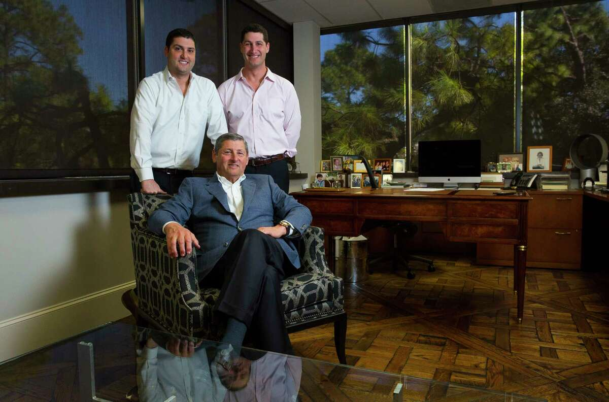 Brothers Kevin and Scott Frankel pose with their father Jim Frankel in their office on Tuesday, Oct.17, 2017, in Houston. (Annie Mulligan / Freelance)