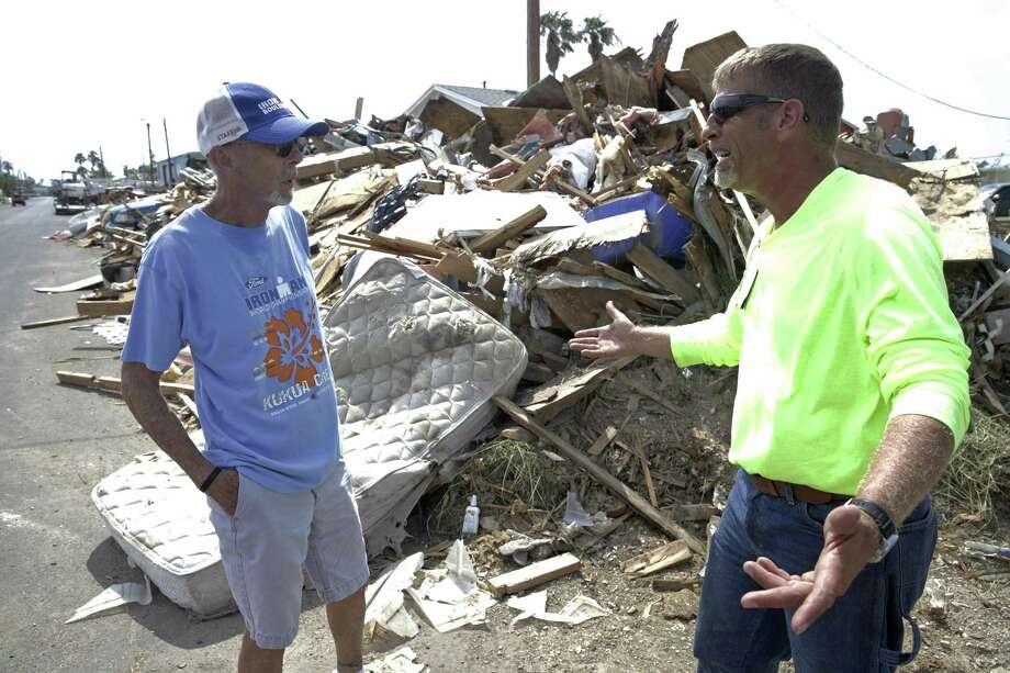 Contractor Matthew Pinkston explains cleanup difficulties to Ed Cheatham who owns several lots of rental homes being demolished as part of the recovery from Hurricane Harvey in Port Aransas. A $1 million donation is slated to fund relief efforts at areas along the coast, including Port Aransas, Refugio and Rockport. Photo: Tom Reel /San Antonio Express-News / 2017 SAN ANTONIO EXPRESS-NEWS