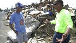 Contractor Matthew Pinkston explains cleanup difficulties to Ed Cheatham who owns several lots of rental homes being demolished as part of the recovery from Hurricane Harvey in Port Aransas. A $1 million donation is slated to fund relief efforts at areas along the coast, including Port Aransas, Refugio and Rockport.