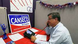 "Francisco ""Quico"" Canseco makes phone calls along side volunteers and supporters during a campaign event at his north west side campaign office, Saturday, October 20, 2012. Canseco (R-SA) is running hard against state Rep. Pete Gallego, (D-Alpine), in the race for U.S. House District 23. (JENNIFER WHITNEY)"