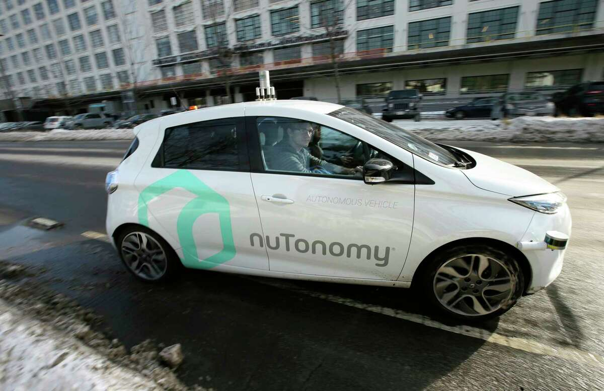 An autonomous vehicle undergoes testing in an industrial park in Boston earlier this year.