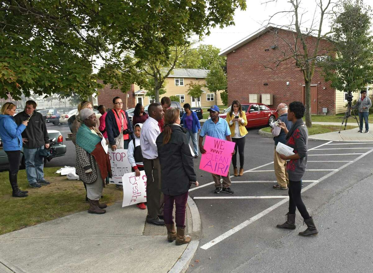 People protest diesel trucks from driving by the Ezra Prentiss homes on Tuesday, Oct 17, 2017 in Albany, N.Y. They want the trucks to be re-routed. (Lori Van Buren / Times Union)