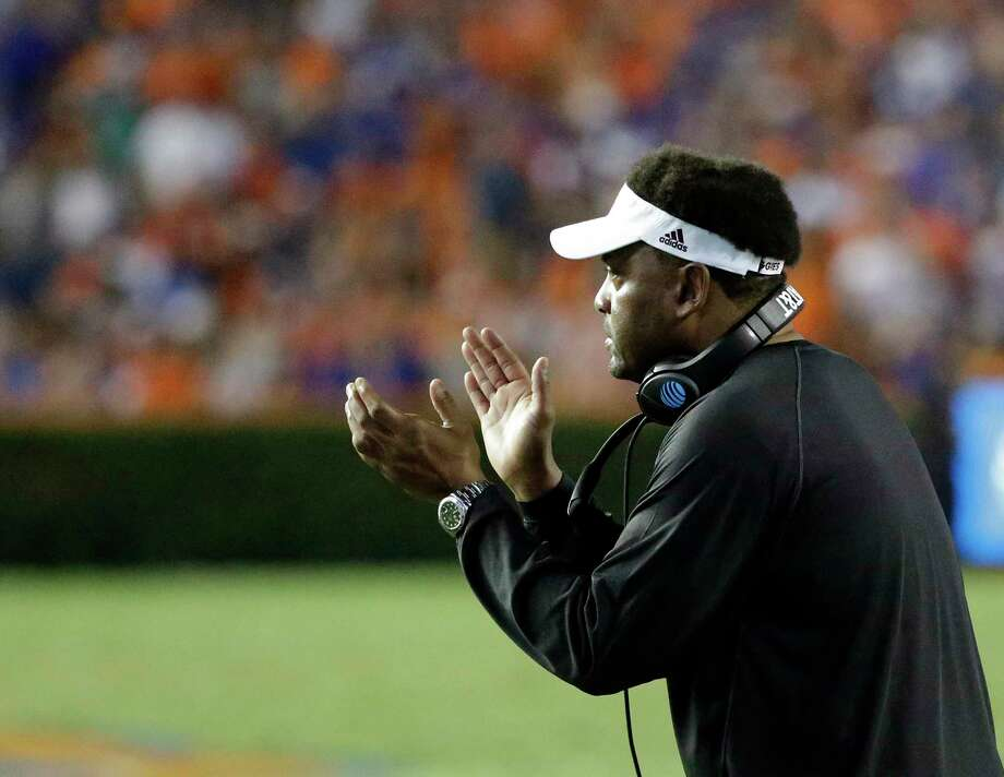 Texas A&M head coach Kevin Sumlin encourages his players during the first half of an NCAA college football game against Florida, Saturday, Oct. 14, 2017, in Gainesville, Fla. (AP Photo/John Raoux) Photo: John Raoux, STF / Copyright 2017 The Associated Press. All rights reserved.