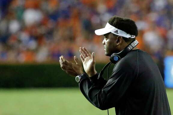 Texas A&M head coach Kevin Sumlin encourages his players during the first half of an NCAA college football game against Florida, Saturday, Oct. 14, 2017, in Gainesville, Fla. (AP Photo/John Raoux)
