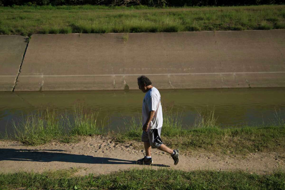 Alvaro Gallardo, 53, likes the way the White Oak Bayou looks the present moment. He thinks the concrete should not be removed. After work and before heading home, he walks the bayou because he finds it a tranquil place. Tuesday, Oct. 17, 2017, in Houston.