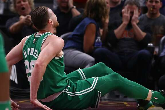 CLEVELAND, OH - OCTOBER 17:   Gordon Hayward #20 of the Boston Celtics is sits on the floor after being injured while playing the Cleveland Cavaliers at Quicken Loans Arena on October 17, 2017 in Cleveland, Ohio. NOTE TO USER: User expressly acknowledges and agrees that, by downloading and or using this photograph, User is consenting to the terms and conditions of the Getty Images License Agreement.  (Photo by Gregory Shamus/Getty Images)