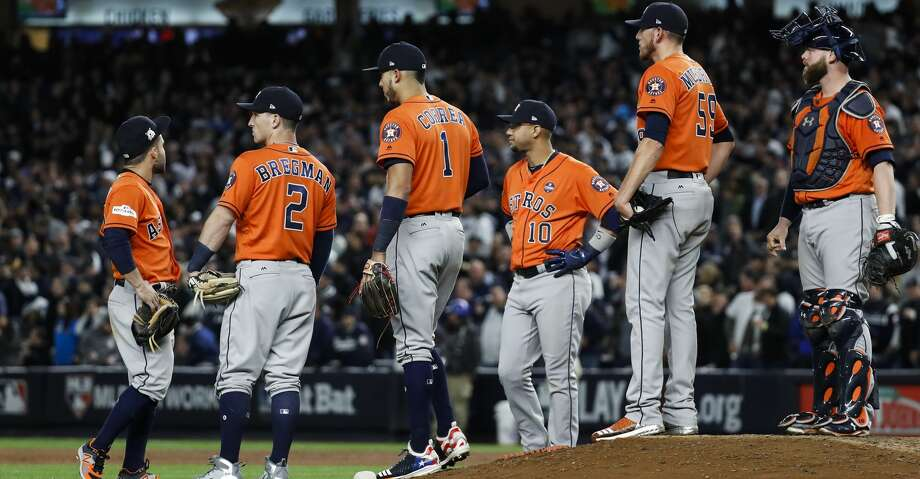 Houston Astros relief pitcher Joe Musgrove (59) stands on the top of the mound surrouned by his teammates as he waits for Ken Giles to come in the game against the New York Yankees during the eighth inning of Game 4 of the ALCS at Yankee Stadium on Tuesday, Oct. 17, 2017, in New York. ( Karen Warren  / Houston Chronicle ) Photo: Karen Warren/Houston Chronicle