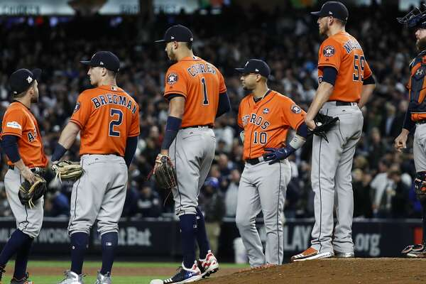 Houston Astros relief pitcher Joe Musgrove (59) stands on the top of the mound surrouned by his teammates as he waits for Ken Giles to come in the game against the New York Yankees during the eighth inning of Game 4 of the ALCS at Yankee Stadium on Tuesday, Oct. 17, 2017, in New York. ( Karen Warren  / Houston Chronicle )