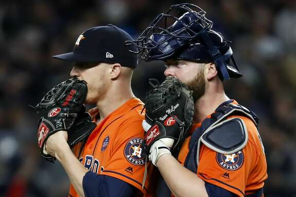 Houston Astros relief pitcher Ken Giles (53) and catcher Brian McCann (16) stand on the mound after the New York Yankees took the lead during the eighth inning of Game 4 of the ALCS at Yankee Stadium on Tuesday, Oct. 17, 2017, in New York. ( Karen Warren  / Houston Chronicle )