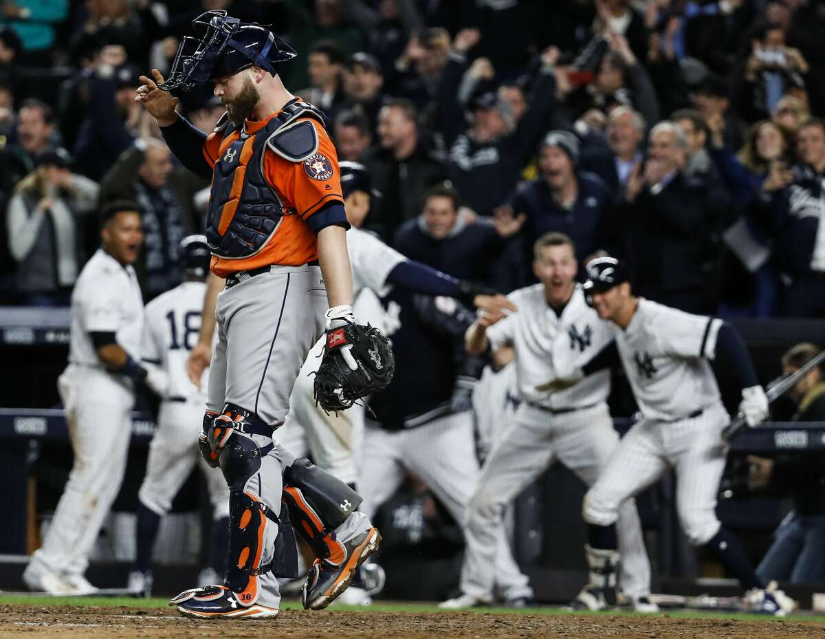 Houston Astros catcher Brian McCann walks to the pitchers mound as the New York Yankees celebrate scoring the go-ahead runs during the eighth inning of Game 4 of the ALCS at Yankee Stadium on Tuesday, Oct. 17, 2017, in New York. ( Karen Warren / Houston Chronicle )