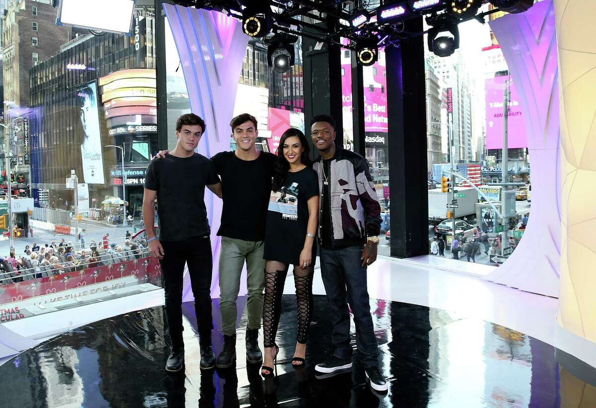 NEW YORK, NY - SEPTEMBER 27: (L - R) TRL Hosts Ethan Dolan; Grayson Dolan, Tamara Dhia, and DC Young Fly attend the MTV TRL Press Junket to promote the relaunch of TRL at MTV Studios on September 27, 2017 in New York City. Charter Communications and Viacom, which owns MTV, announced Tuesday, Oct. 17, 2017, they had agreed in principle on a new contract. (Photo by Bennett Raglin/Getty Images for MTV TRL)