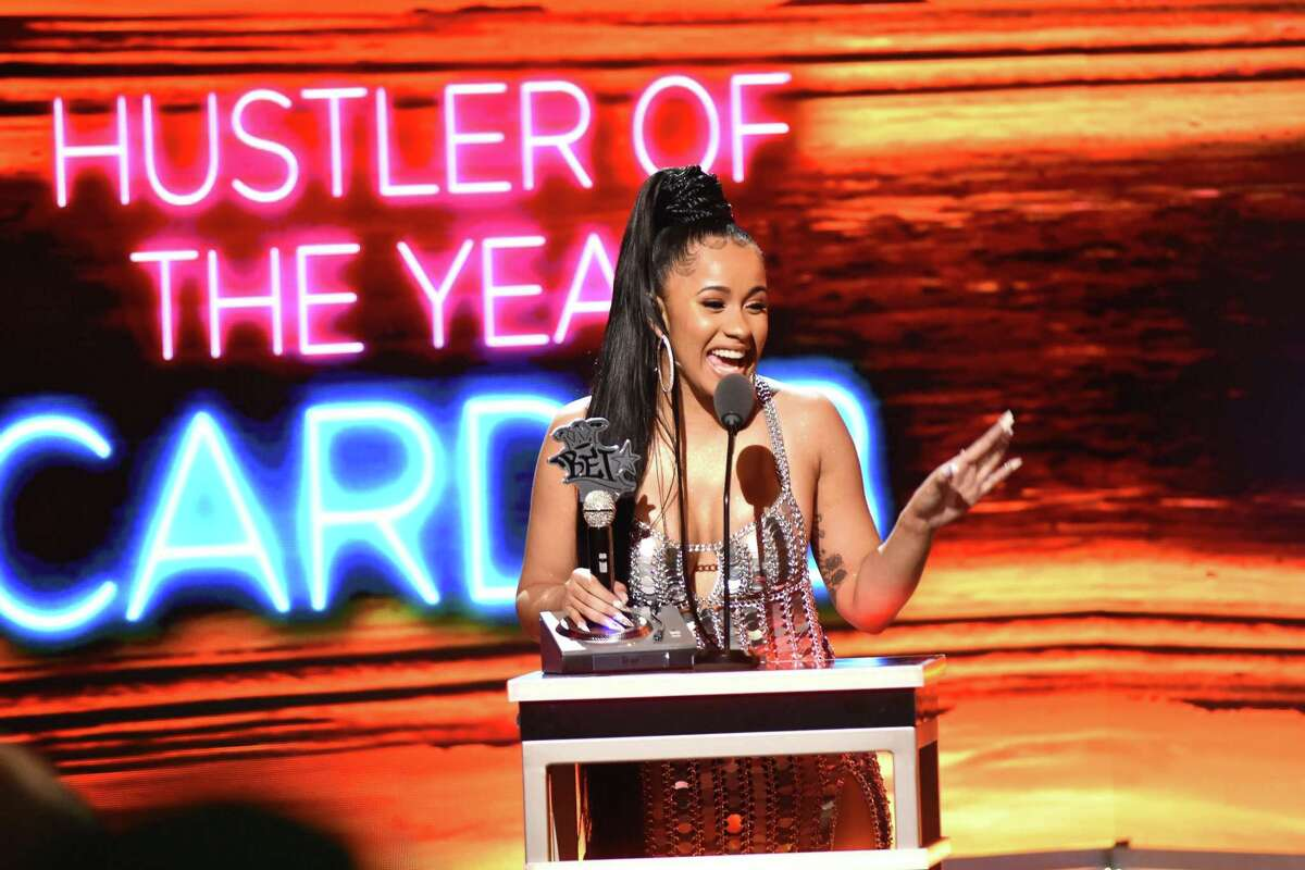 Rapper Cardi B receives the award for Hustler of the Year during the BET Hip Hop Awards 2017 at The Fillmore Miami Beach at the Jackie Gleason Theatre on October 6, 2017 in Miami Beach, Florida. ASTON DE CARDENAS/AFP/Getty Images