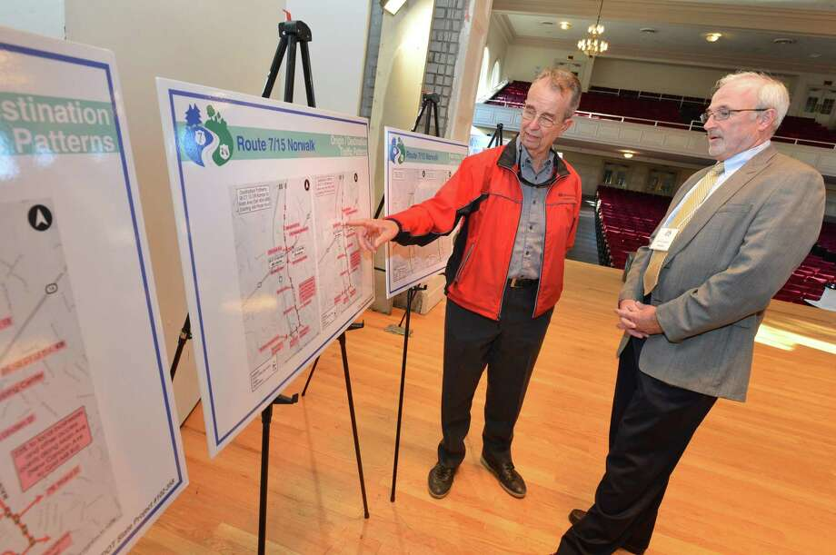 John Eberle, Principal with consulting engineer Stantec, answers some questions about traffic patterns for resident Martin Weimer during Connecticut Department of Transportation's  public meeting on the upcoming overhaul of Route 7 and the Merritt Parkway at Norwalk City hall on Tuesday October 17, 2017 in Norwalk Conn. Photo: Alex Von Kleydorff / Hearst Connecticut Media