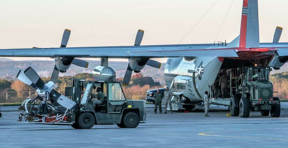 Members of the 109th Airlift Wing load two LC-130 fitted for snow landings for their annual trip to the Antarctic from Stratton Air National Guard base Tuesday Oct. 17, 2017 in Scotia, N.Y.  (Skip Dickstein/Times Union) Photo: SKIP DICKSTEIN / 20041859A