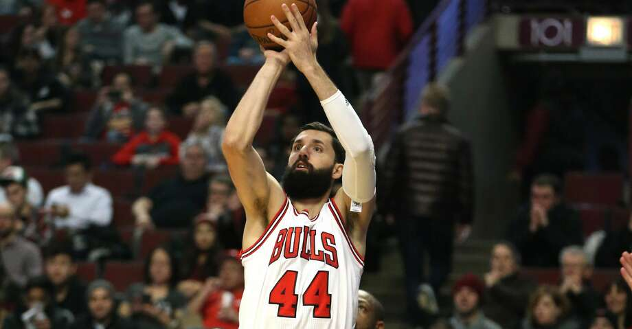 Chicago Bulls forward Nikola Mirotic (44) makes a basket against the Washington Wizards on December 21, 2016, at the United Center in Chicago. Mirotic is expected to miss the team's 2017-18 season opener after an altercation with teammate Bobby Portis during practice. (Nuccio DiNuzzo/Chicago Tribune/TNS) Photo: Nuccio DiNuzzo/TNS