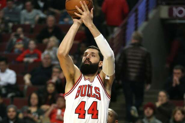 Chicago Bulls forward Nikola Mirotic (44) makes a basket against the Washington Wizards on December 21, 2016, at the United Center in Chicago. Mirotic is expected to miss the team's 2017-18 season opener after an altercation with teammate Bobby Portis during practice. (Nuccio DiNuzzo/Chicago Tribune/TNS)