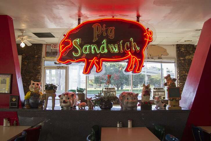 The neon pig sandwich sign in the San Antonio Pig Stand dining room dates back to 1924. It used to sit outside the restaurant, but was moved inside in 1975 to preserve it.