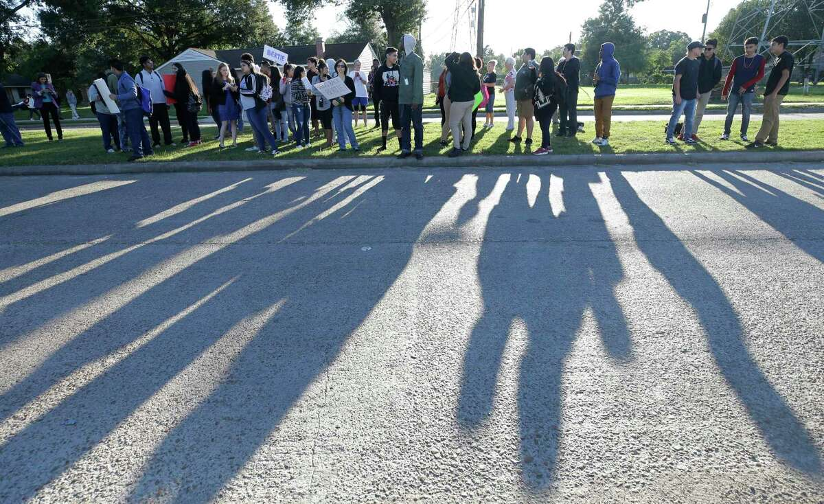 """Students gather outside Furr High School on Tuesday to protest the removal of Principal Bertie Simmons. """"Everyone is bummed,"""" one student said. """"Everyone wants to bring Dr. Simmons back."""""""