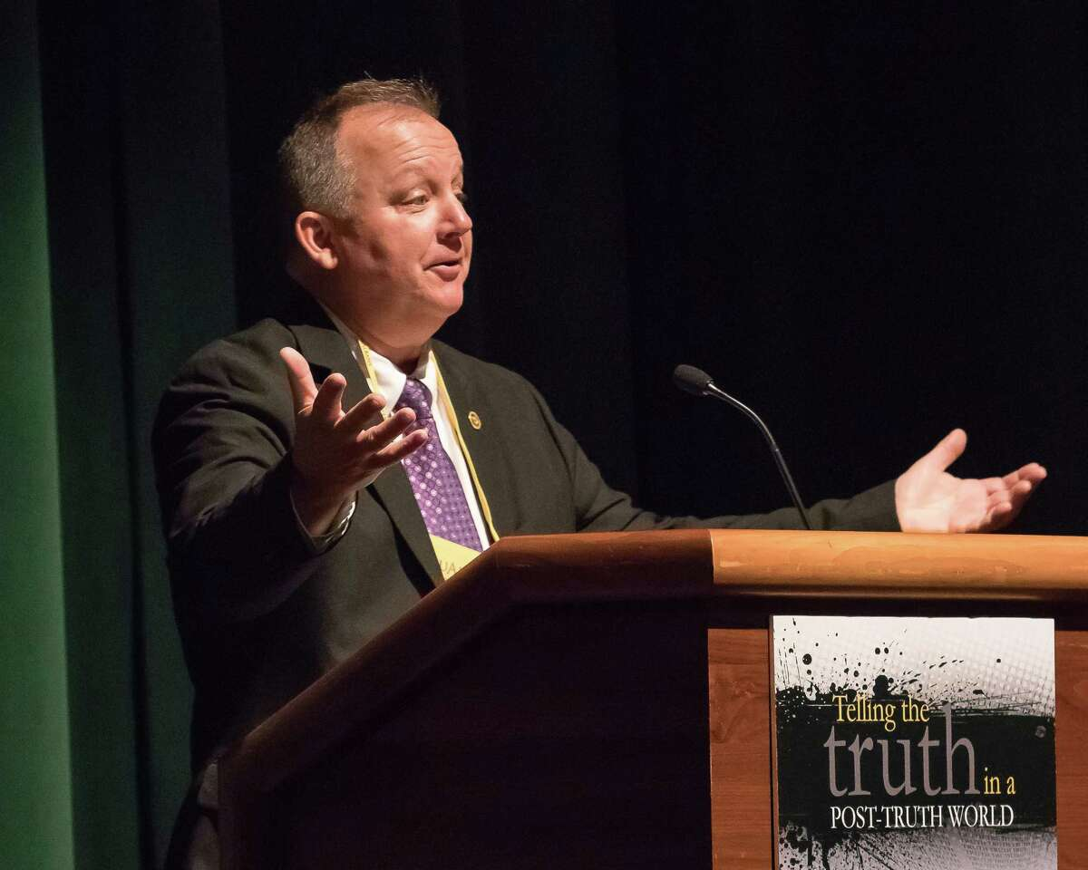 Paul Grondahl, director of the New York State Writers Institute, addresses the crowd at the institute's weekend seminar