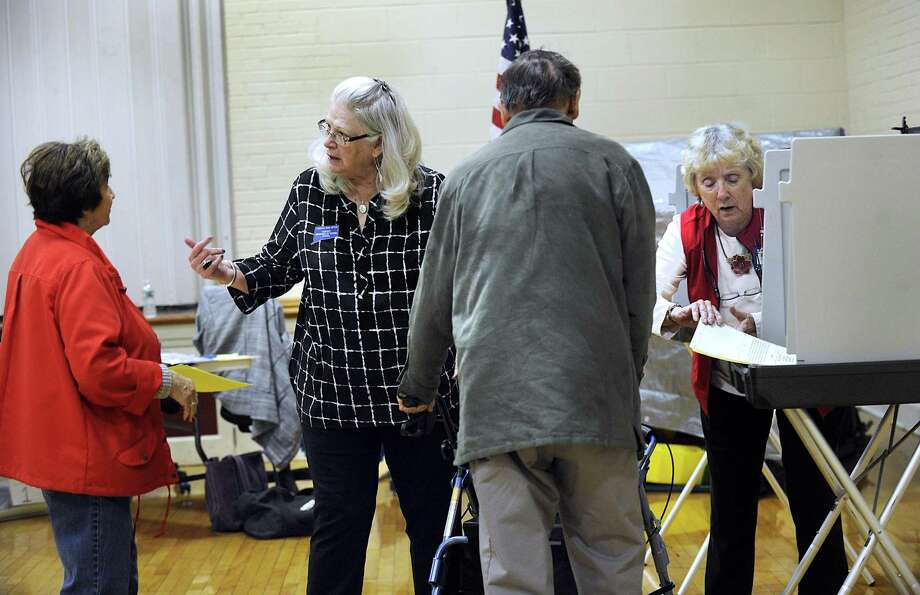Carole Ritch, left, and head moderator, and Flo Murphy, assistant Republican registrar, assist voters at the Municipal Center polling place in Bethel Tuesday, Oct. 17, 2017. Bethel residents are vote on the $65.8 million elementary school renovation project. Photo: Carol Kaliff / Hearst Connecticut Media / The News-Times