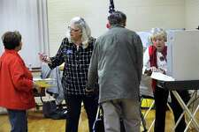 Carole Ritch, left, and head moderator, and Flo Murphy, assistant Republican registrar, assist voters at the Municipal Center polling place in Bethel Tuesday, Oct. 17, 2017. Bethel residents are vote on the $65.8 million elementary school renovation project.