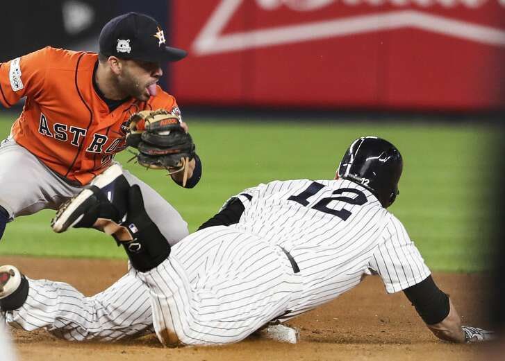 Houston Astros second baseman Jose Altuve (27) can't make the tag on New York Yankees third baseman Chase Headley (12) as he slide under Altuve's tag during the eighth inning of Game 4 of the ALCS at Yankee Stadium on Tuesday, Oct. 17, 2017, in New York. ( Michael Ciaglo / Houston Chronicle )