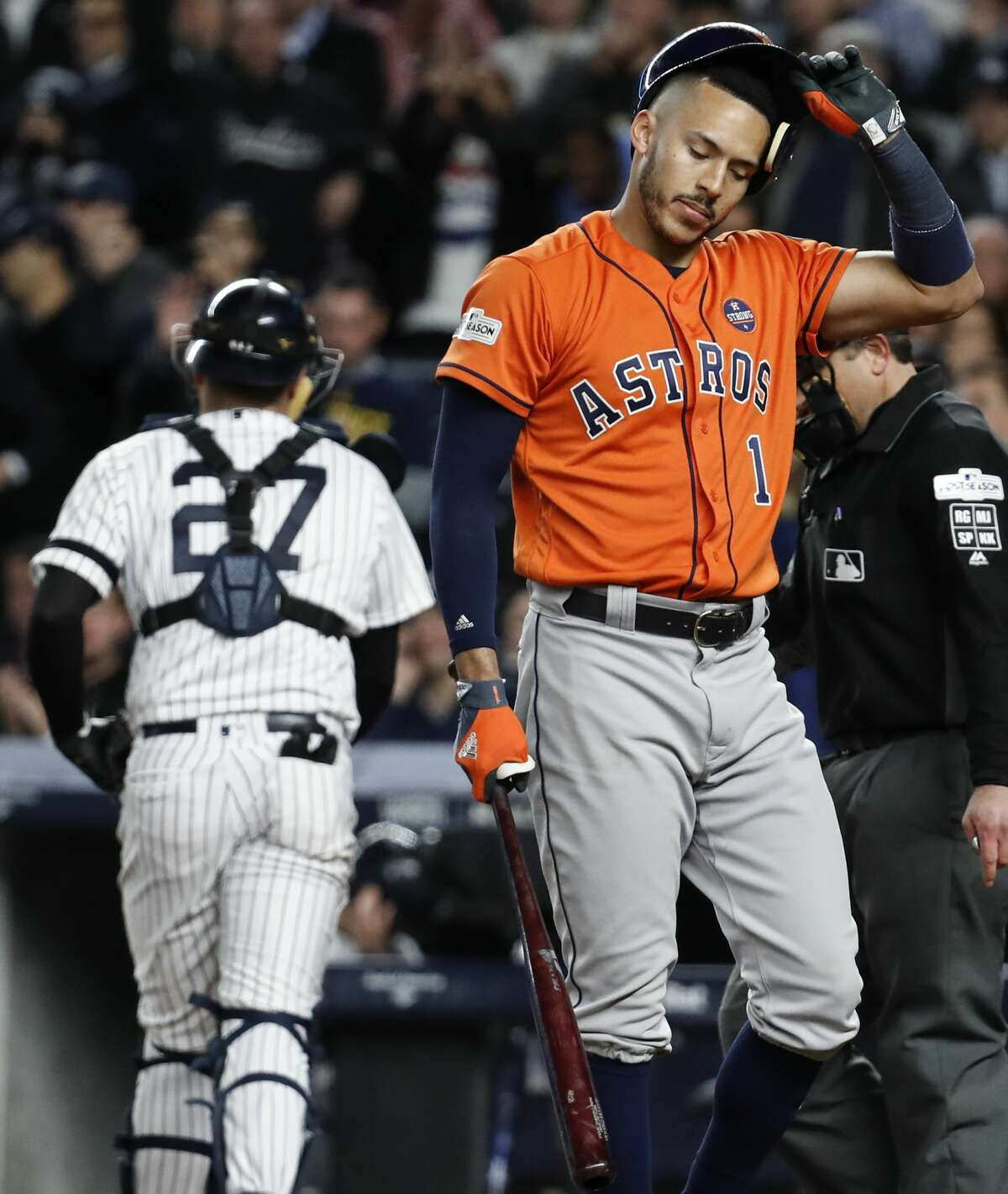 Houston Astros shortstop Carlos Correa (1) walks off the field after striking out to end the top of the eighth inning of Game 4 of the ALCS against the New York Yankees at Yankee Stadium on Tuesday, Oct. 17, 2017, in New York. ( Karen Warren / Houston Chronicle )