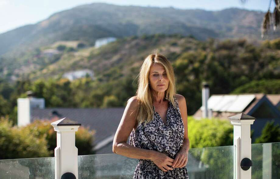 "Catherine Oxenberg, who was informed that her daughter, India, had become part of the self-help group Nxivm's secret sorority, in Malibu, Calif., July 29, 2017. Though many people take the self-help group's workshops and move on with their lives, others have become drawn more deeply into Nxivm, getting branded and giving up careers, friends and families to become followers of its leader, Keith Raniere. ""I felt sick to my stomach,"" said Oxenberg after learning India was in the secret society. (Ruth Fremson/The New York Times) ORG XMIT: XNYT173 Photo: RUTH FREMSON / NYTNS"