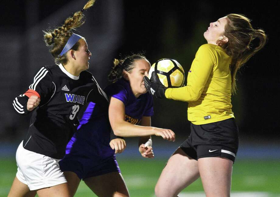 Westhill goalie Niamh Keogh makes a save as she collides with teammate Erica Shaulson (22) and Darien Emily DeNunzio (19) in a FCIAC girls soccer game in Darein, Connecticut on Tuesday, Oct.17, 2017. Photo: Matthew Brown / Hearst Connecticut Media / Stamford Advocate