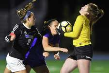 Westhill goalie Niamh Keogh makes a save as she collides with teammate Erica Shaulson (22) and Darien Emily DeNunzio (19) in a FCIAC girls soccer game in Darein, Connecticut on Tuesday, Oct.17, 2017.