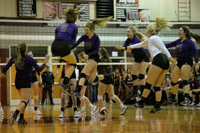 Midland High volleyball players celebrate a set win against Lee on Oct. 17, 2017, at Lee High School. James Durbin/Reporter-Telegram