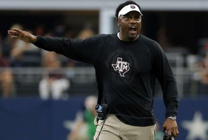 In this Sept. 23, 2017, file photo, Texas A&M head coach Kevin Sumlin talks to an official, not pictured, after a call during an NCAA college football game against Arkansas, in Arlington, Texas.