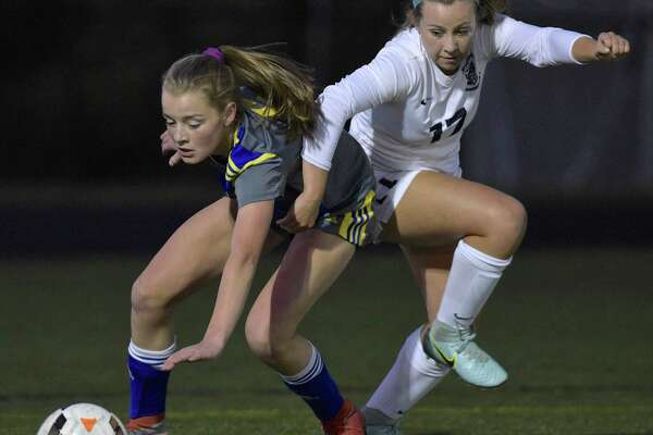 Newtown's Karsen Pirone (6) and Immaculate's Jillian Fredette (17) fight for the ball in the corner during the girls soccer game between Newtown and Immaculate high schools on Tuesday night, October 17, 2017, at Immaculate High School, Danbury, Conn.