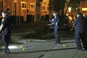 Police investigate the scene where shell casings were found on the pavement as two children were injured in a shooting in an apartment complex at 3735 E. Commerce on Oct. 17, 2017. It was one of the 10,759 violent crimes reported in San Antonio last year.