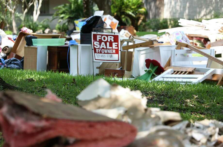 "A ""For Sale"" sign went up last month in front of a flood-damaged home in Meyerland, one of thousands in the Brays Bayou watershed damaged by Harvey. Photo: Yi-Chin Lee, Staff / © 2017  Houston Chronicle"