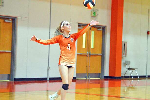 Edwardsville senior Delaney Allen makes a serve during the second game of Tuesday's Southwestern Conference home match against Belleville West.