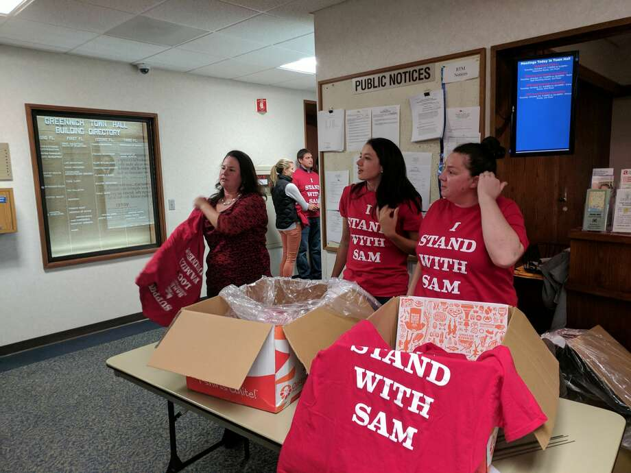 (Right to left) Amy Palmer, Lauren Bridge and Jena Palmer distributed shirts at Greenwich Planning and Zoning Tuesday evening in support of Sam Bridge Nursery and Greenhouse. Their amendment to municipal code was approved without additional measures to reduce noise. Photo: Jennifer Turiano